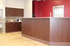 Altyno film installation on cabinets and reception desk at retail automotive center  in the Raleigh-Durham area (after photo).