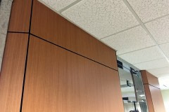 Custom wall panel built for lobby renovation in the Raleigh-Durham area. This shows the finished walls after being wrapped with Belbien wood grain vinyl film.