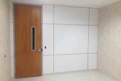 Custom wall panel built for lobby renovation in the Raleigh-Durham area. This shows the blank panels before film is installed.