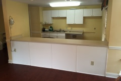 Belbien film installation on kitchen cabinets at nursing home facility in the Washington D.C. area (before photo).