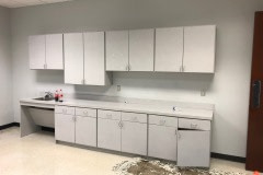 Belbien film installation on office kitchenette cabinets in the Raleigh-Durham area (before photo).