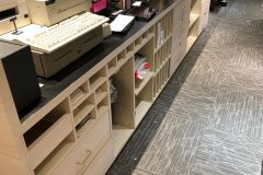 Architectural Fusions partnered with a national retailer to resurface the walls, display cases, cabinets, storefronts