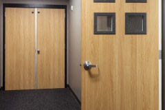 Commercial door wrap using architectural vinyl film.