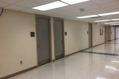 Architectural vinyl film was installed on over 300 main level doors at a hospital in eastern North Carolina (before photo).