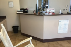 Altyno film installation on cabinets and reception desk at retail automotive center in the Raleigh-Durham area (before photo).